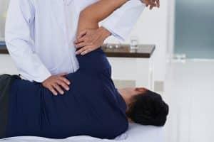 chiropractor adjusting patients shoulder