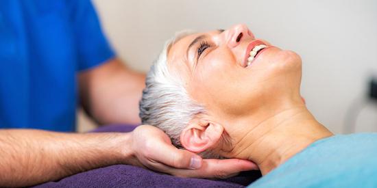 chiropractor holding patient head