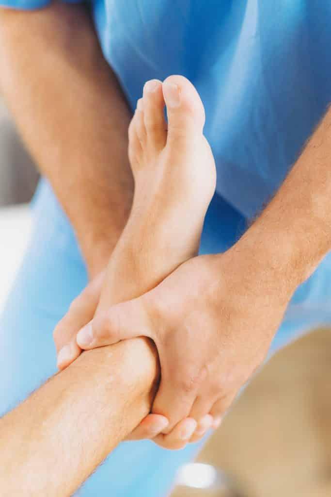 chiropractor adjusting patients foot
