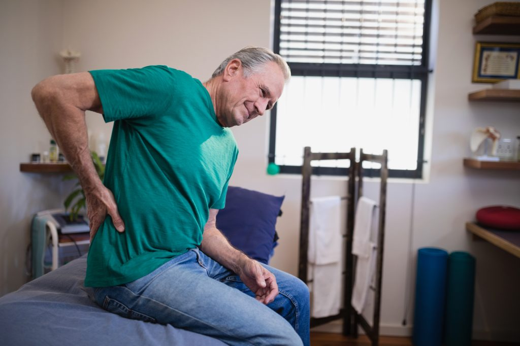 elderly man having back pain