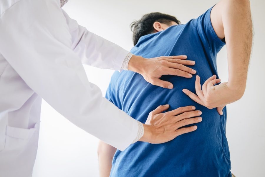 Chiropractor helping a patient with a pinched nerve